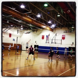 Rob playing indoor volleyball in a gym near his hometown in PA