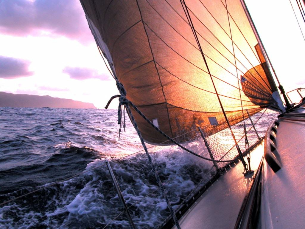 sailing to sunrise on the horizon line