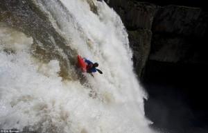 tyler bradt kayaking over waterfall on the horizon line
