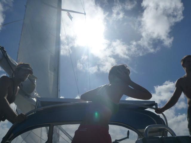 sailing through waves in tuamotus on the horizon line bri and rob travel and sailing adventure tuamotus