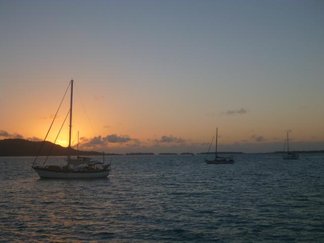 sailboats at sunset south pacific travel