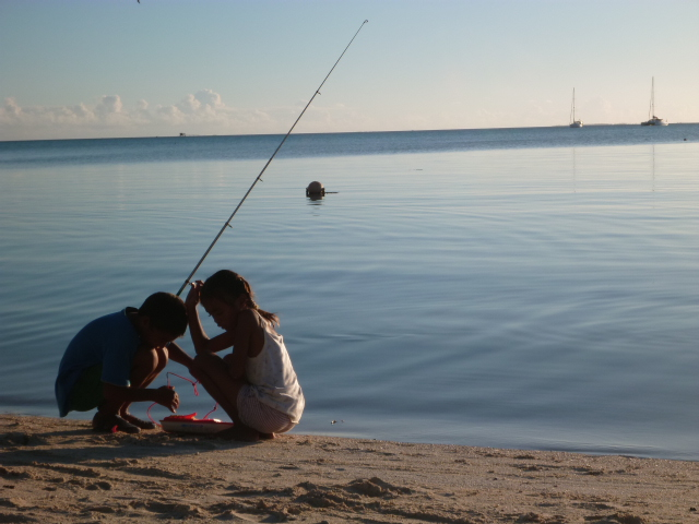 Kids fishing on the shore
