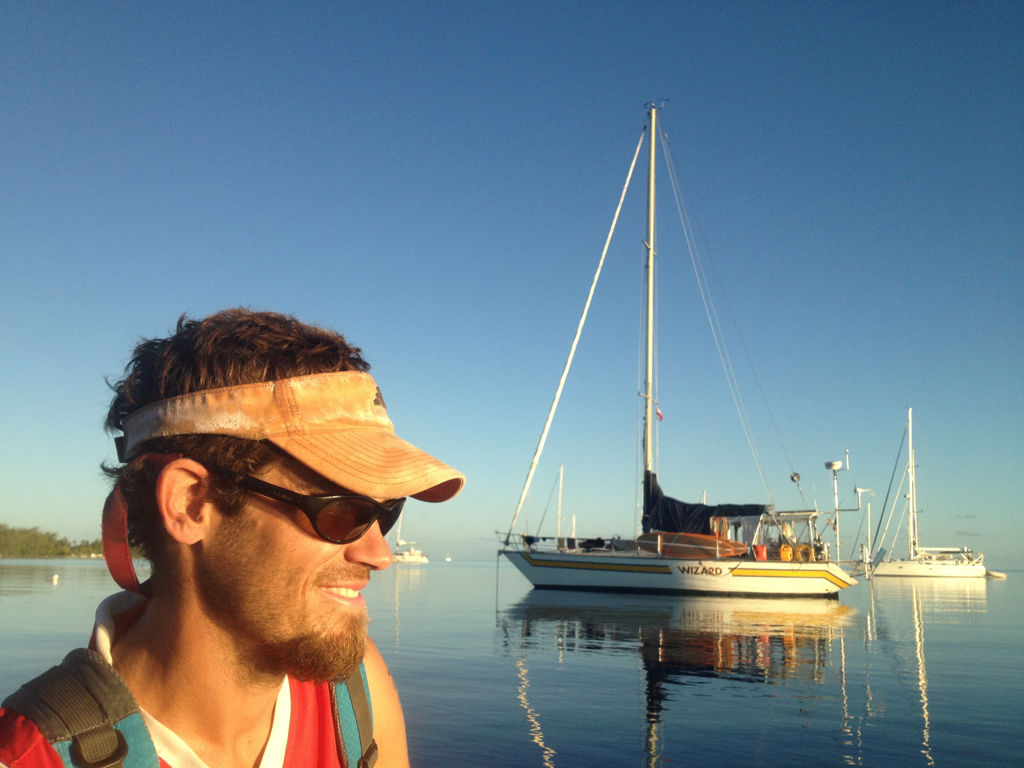 Rob takes in the sunset on a dinghy ride back to the 40 foot sloop, Wizard, owned by John and Sue out of California.