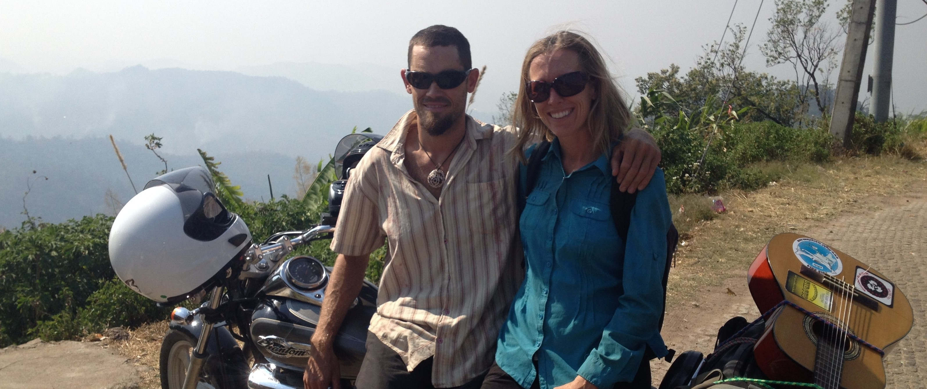 Brianna Randall and Rob Roberts on motorcycle through Thailand's Mae Hong Son Loop. On the Horizon Line travel blog.