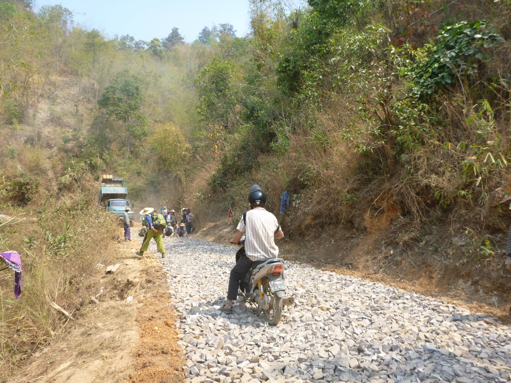 Scooter over construction on Burma roads - Trekking in Myanmar village - Brianna and Rob - On the Horizon Line Travel Blog