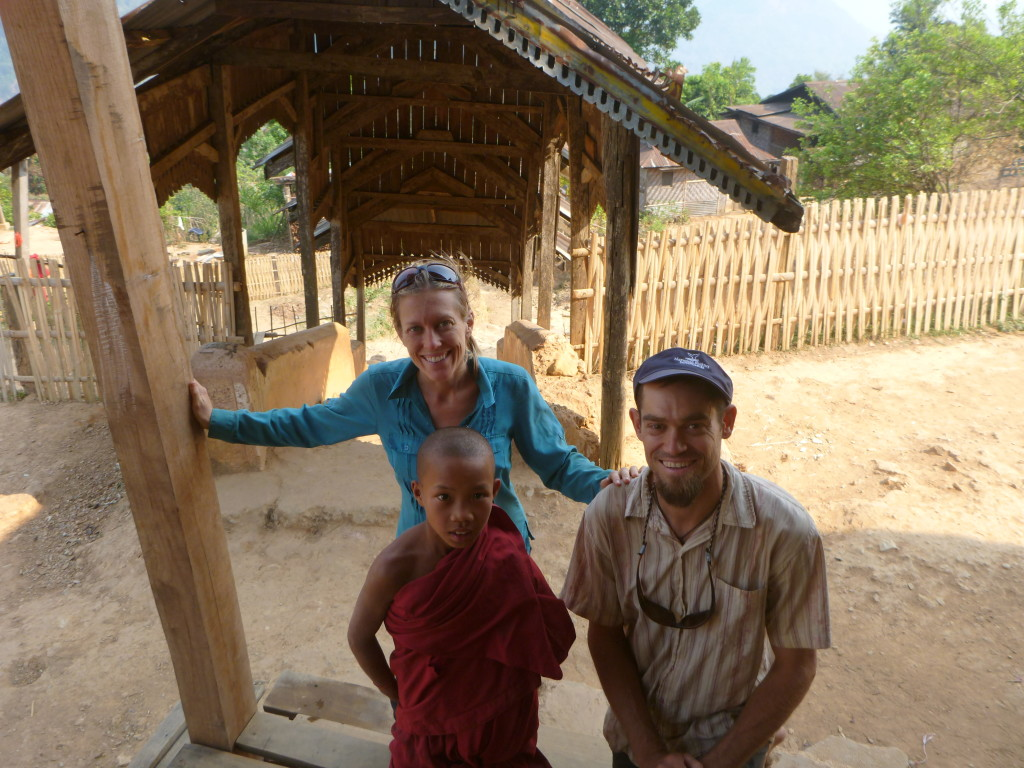 bri and Rob with young Buddhist Monk - Trekking in Myanmar village - Brianna and Rob - On the Horizon Line Travel Blog