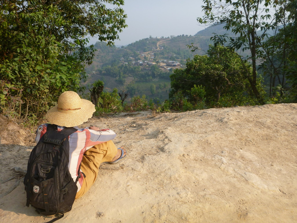 Trekking in Myanmar - Burmese guide looking over tea villages - On the Horizon Line travel blog.