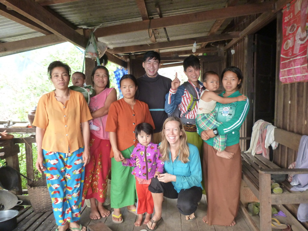 Bri with Shan family in Myanmar village - Brianna and Rob - On the Horizon Line Travel Blog