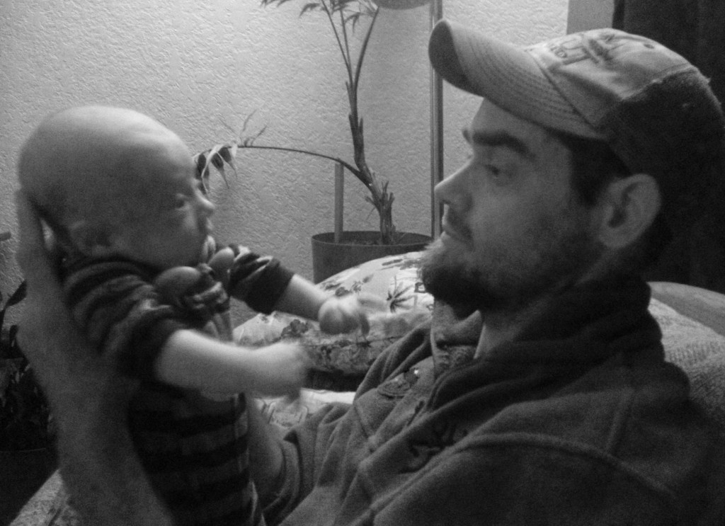 rob roberts  and talon in black and white smiling