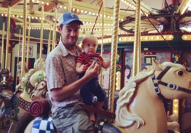 rob and talon on the carousel in missoula