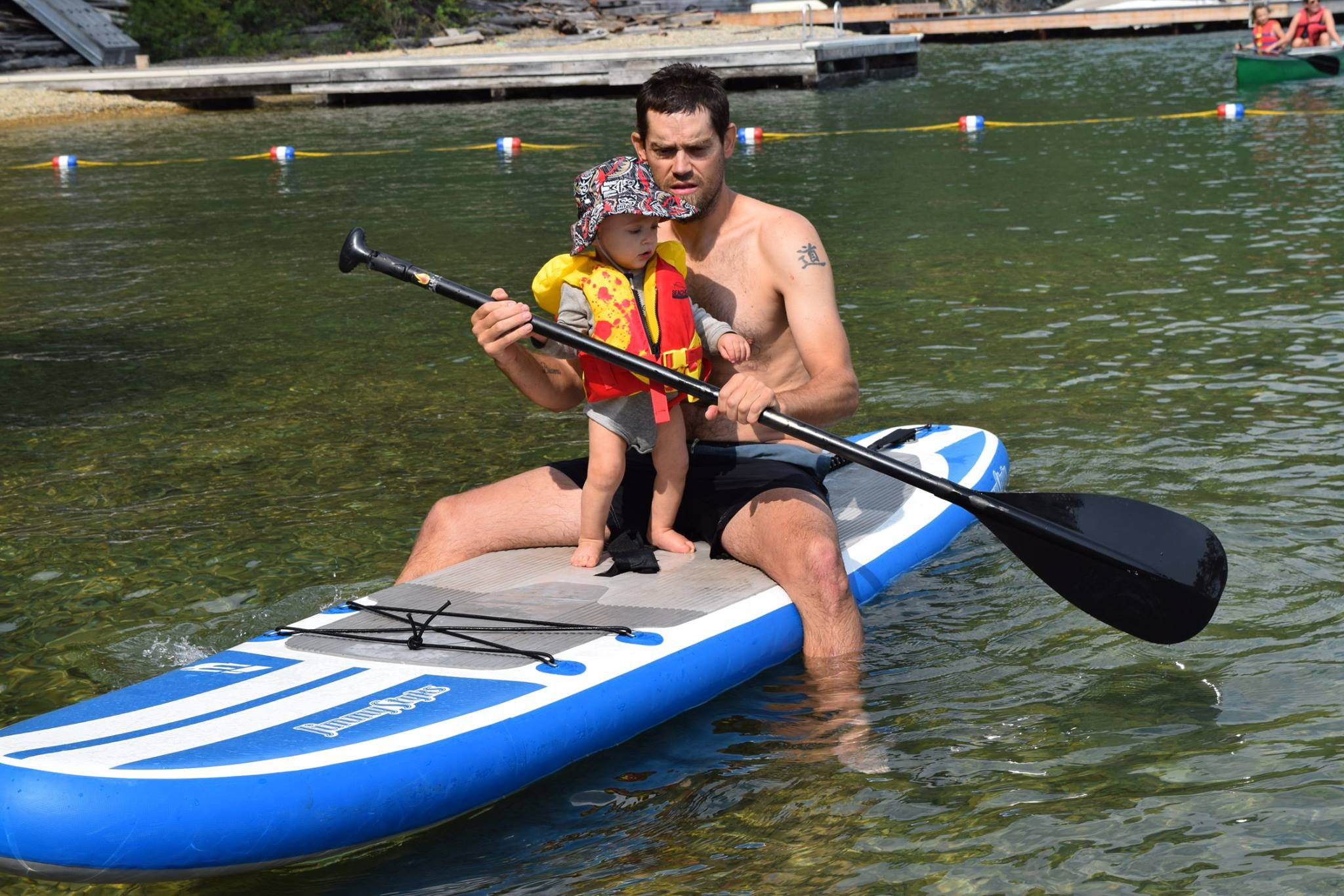 rob roberts and talon on a standup paddleboard on flathead lake